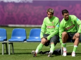 Portugal´s defender Fabio Coentrao (L) and forward Cristiano Ronaldo (R) prepare for a training session at the team's base camp on June 7, 2012 in Opalenica, two days ahead of the team's Euro 2012 opening football match against Germany. AFP PHOTO/ FRANCISCO LEONG        (Photo credit should read FRANCISCO LEONG/AFP/GettyImages)