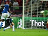 Italian forward Mario Balotelli shoots to score the second goal during the Euro 2012 football championships semi-final match Germany vs Italy on June 28, 2012 at the National Stadium in Warsaw.  AFP PHOTO / FRANCISCO LEONG        (Photo credit should read FRANCISCO LEONG/AFP/GettyImages)